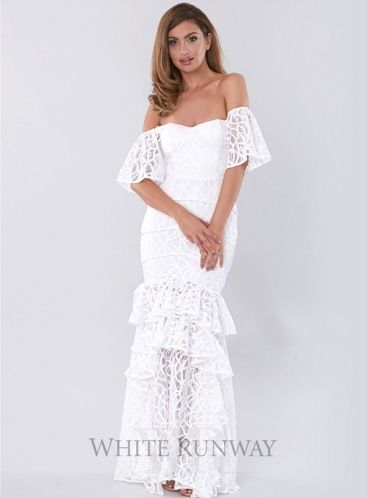 Moments Later Dress. A gorgeous floor length dress by Asilio. An off-shoulder sweeatheart neckline that follows into sheer gathered cap sleeves. Features ruffled panels that cascade around the lower thigh and down the sides of the hem, creating a dramatic fluted shape.