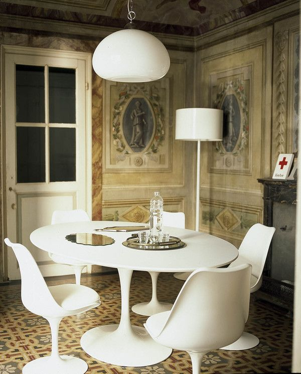 The dining room with an old Saarinen table and chairs.