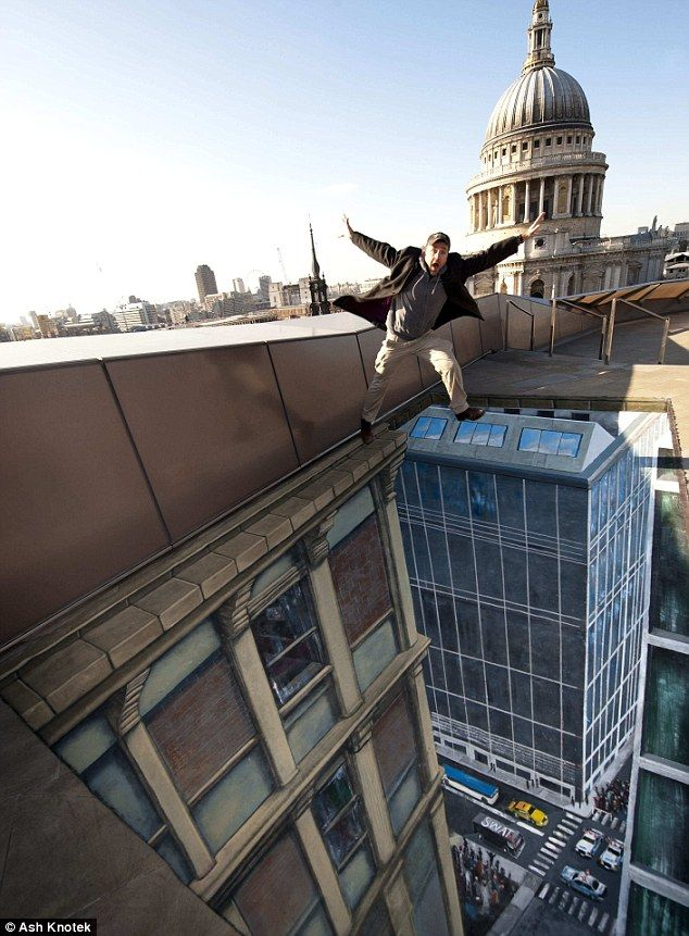 Don't jump! Oh, he can't... Incredible chalk drawings that appear to change London's skyline | Mail Online