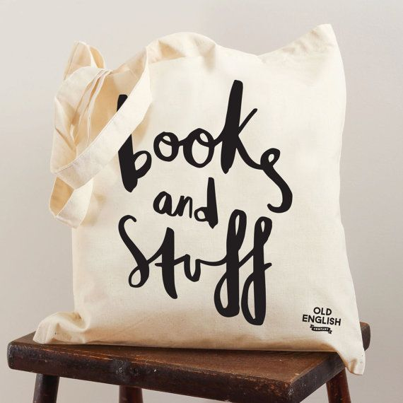 This canvas tote bag has been illustrated with the hand lettered message Books and stuff. The books canvas tote bag would make a great gift for