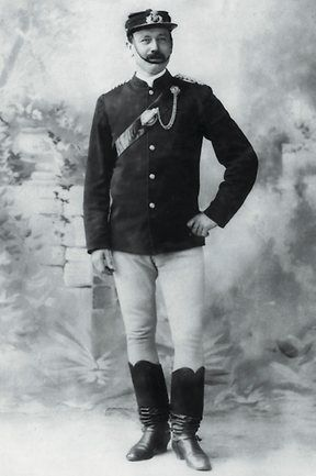 Victorian mounted police officer circa 1880s. Wearing an officer's Keppi cap and silver bullion QVC badge.