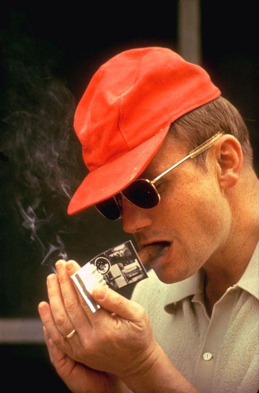 Neil Armstrong smoking a cigar/ First cigar smoker on the moon.