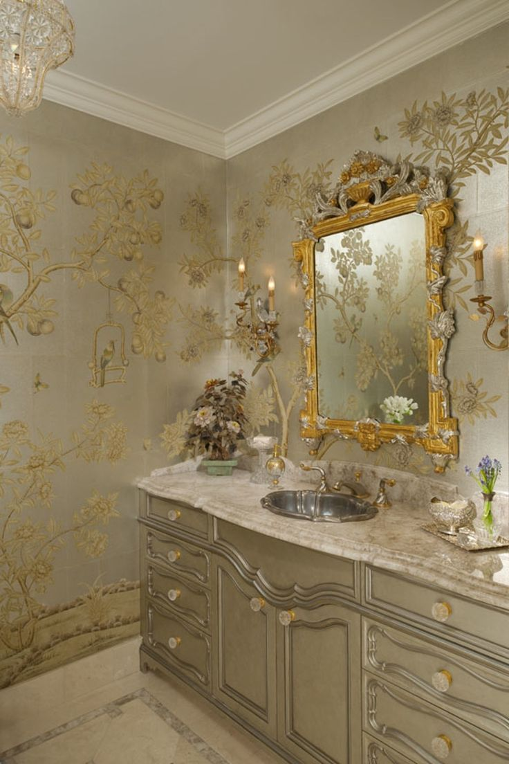 Of particular note is thispowder room which is adorned with hand painted Chinese scenic wallpaper, a custom vanity decked in white quartz, an antique mirror, and mirrored sconces designed to echo the rooms bird motif  Bath  Asian  TraditionalNeoclassical by Sherry Hayslip Interiors & Hayslip Design Associates, Inc