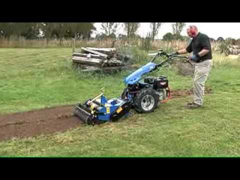 The Stone Burier attachment has counter-rotating tines that mill the ground whilst grading rods trap stones and other debris allowing the soil to be thrown on top.   In just one pass the Stone Burier leaves a fine, level tilth ready for turfing or seeding, with no additional raking required. The digging depth is adjustable between 2cm and 12cm and the desired depth is easily achieved by adjusting the rear roller.