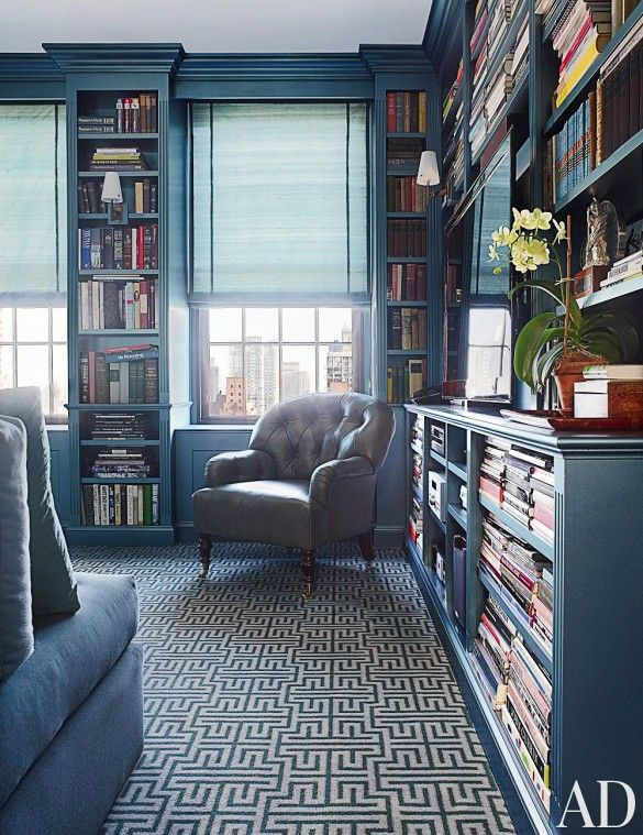 By far the dominant color in this sophisticated library, this deep blue hue feels masculine and sophisticated. By playing with texture and using the same color in a variety of places—carpet, paint, upholstery, leather—the designer has ensured the room feels dynamic rather than flat or one-note.