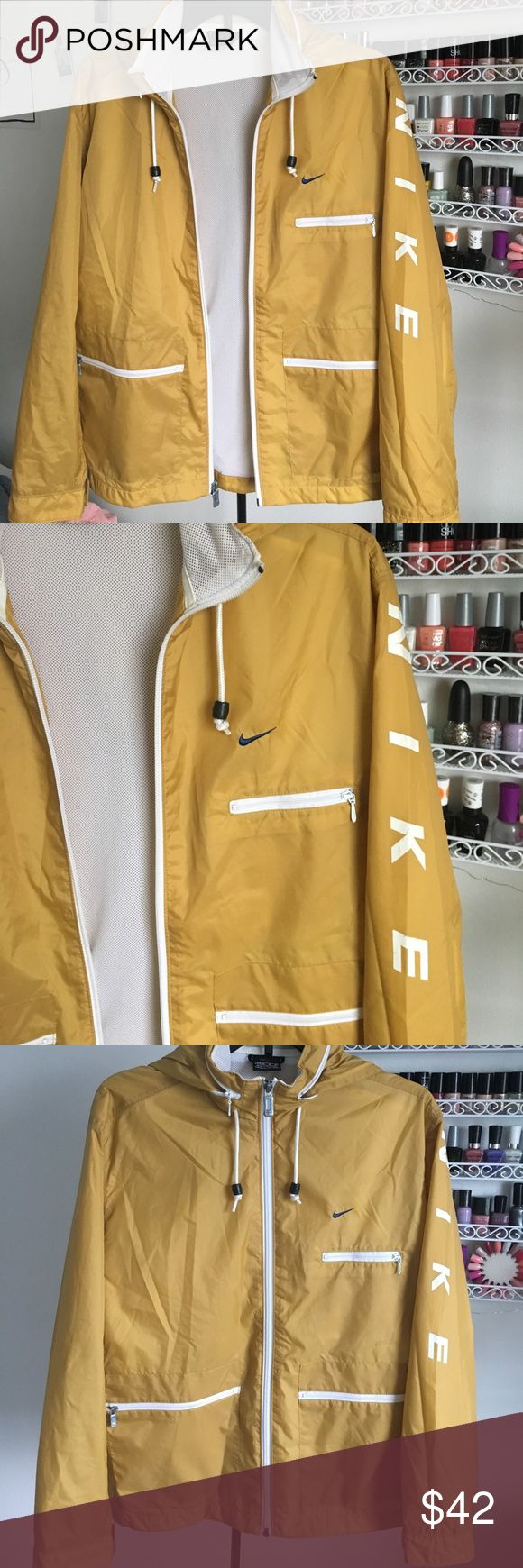 Vintage Nike Windbreaker Rain Jacket ☔️ - Mustard Yellow Windbreaker Rain Jacket by Nike (Vintage, found at an antique store) - LIGHTWEIGHT FOR SPRING - multiple zipper pockets and a hood that can be inserted and hidden into the collar of the jacket! - adjustable em sleeves (can be tightened or loosene) MAKE AN OFFER Nike Jackets & Coats Utility Jackets