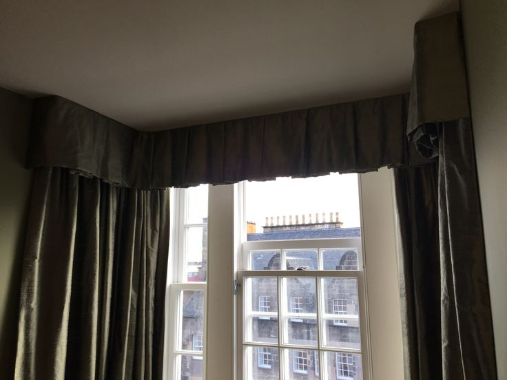 Silk box-pleat valance with interlined silk pencil pleat curtains. This looked great in a relatively small bay window. Gave the living room a cosy and intimate feeling. We measure, make and fit all items.