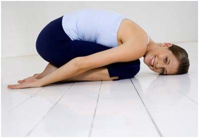 7 Yoga Exercises For Neck Pain Worst neck pain of my life.  Need to stop holding tension on my neck while working out.  :/