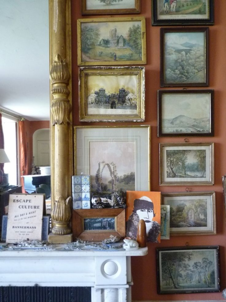 English country _ The pictures are rarely hung perfectly. Love this.