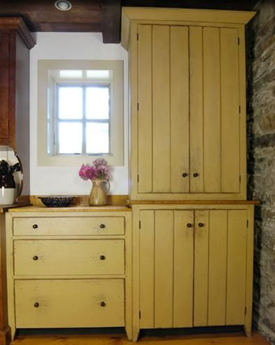 Love the color, and the cabinets! What I want instead of regular kitchen cabinets!