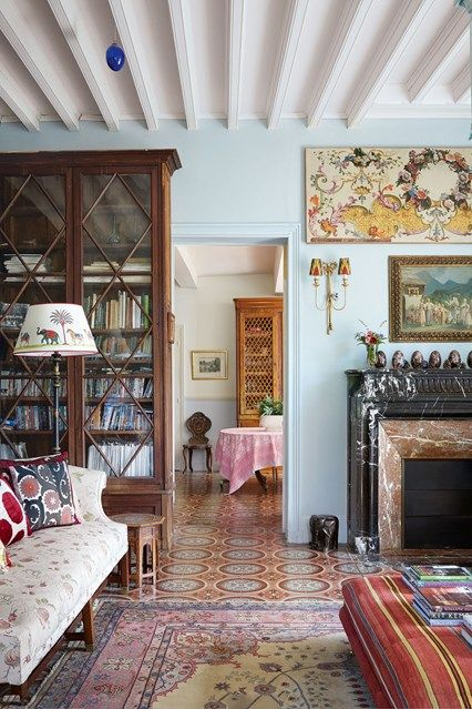 Eclectic Patterned Living Room in the eighteenth-century French country home of textiles dealer Susan Deliss - deep in rural Burgundy with traditional colourful interiors.