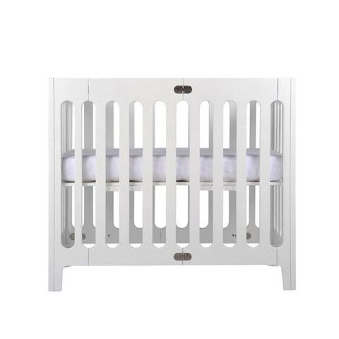 Bloom Alma Mini Crib, about the same size as a standard cradle or bassinet but lasts up to a year or more depending on baby's size. Folds for portability or storage, solid wood, lockable castors. Quite expensive, especially if you buy the organic mattress for it, but might be worth it for tight spaces or to take the place of several gear pieces like a separate bassinet, crib, pack n play, travel crib, etc.