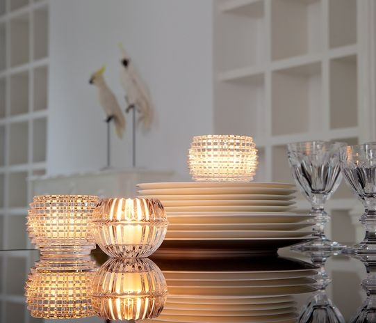 The exquisitely crafted form designed for baccarat by nicolas triboulot is underscored by the