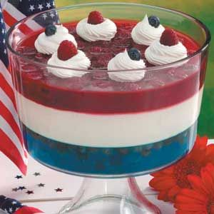 "RED WHITE and BLUE TRIFLE.  Our striking ""flag"" salad drew plenty of attention at our Independence Day party. The shimmering stripes are formed with distinctive gelatin layers.  With layers of fresh blueberries, raspberries and sugar sweetened sour cream..."