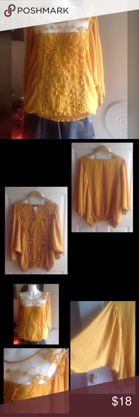 "Lovely blouse Mustard\honey gold color top. Gently worn. With knit detailing on the front. Batwing sleeves with elastic around waist of shirt. Size chart in last photo. From shoulder to bottom length is 26"". Please see small hole in the knit detailing in the front ( last photo). Price reflects imperfection. Tops"