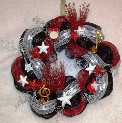 Music deco mesh wreath...would be super cute for a band hall...in school colors =)