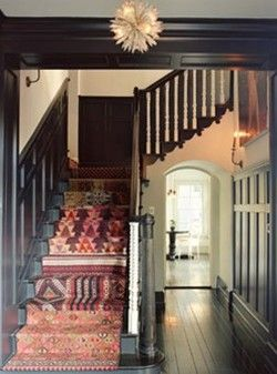 If I didn't live with a sweet, but constantly shedding Golden Retriever with Farrah Fawcett fur...wooden staircase with kilim rugs would be nice.
