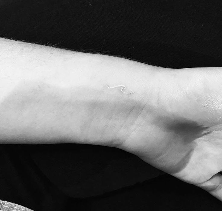 Minimal white ink wave tattoo on wrist. This is now the wave tattoo I want to get!