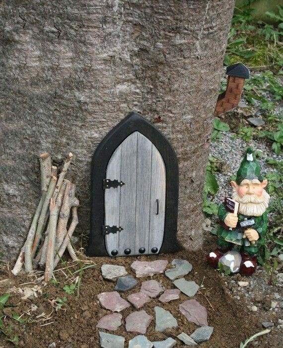 Gnome Door ~ Reminds me of my childhood...I swore there were gnomes living in a tree in our back yard.  Must get this!