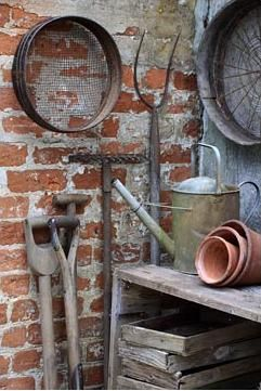 Garden Textures...weathered brick wall with old tools, metal garden can, clay pots...