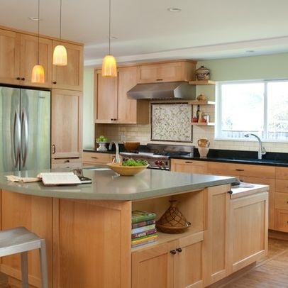 maple cabinets with green walls