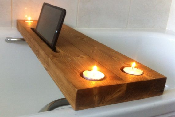 I am pleased to offer for sale this chunky solid pine bath tray. It features 4 circular holes for holding tealight candles and a 30cm long channel to hold an ipad or tablet. The tray measures 67cm x 18cm and is 3.3cm deep. This is designed to fit a standard size bath but if you would like a price for a different size please get in touch. The tray has been sanded to a smooth finish, finished in an oak wax and then spray varnished to ensure an even finish that will protect the wood from…