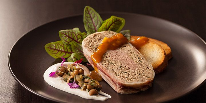 New Year's Duck Terrine | Ring in the New Year with this elegant triple duck terrine drizzled with ginger-orange honey mustard coulis and layered on crostini with duck fat infused whipped cream and a spicy black-eyed pea pesto.