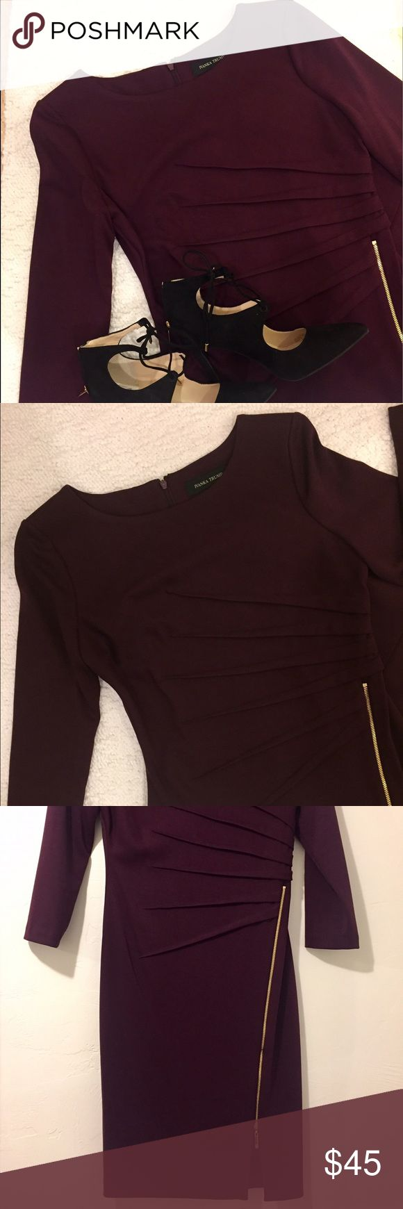 Plum Ivanka Trump dress This beautiful Ivanka Trump dress is in perfect condition. Quarter sleeves. Soft material with a beautiful color. Love the gold accent zipper in the front. Only worn once. First two photos are from boutique online. Ivanka Trump Dresses Midi