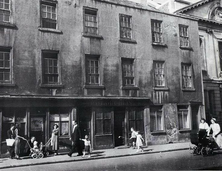Cuffe Street, 1950, these building were demolished and replaced with flats, to the right the church building still exists.