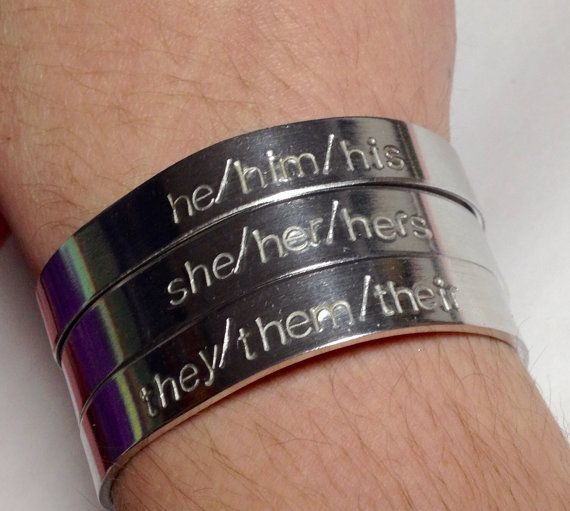 Etsy seller GreatBigBagOTrinkets hand-stamps ANY pronouns you want on aluminum bracelets. Available pronouns: any, custom. Ships worldwide from CA, USA. USD$14.