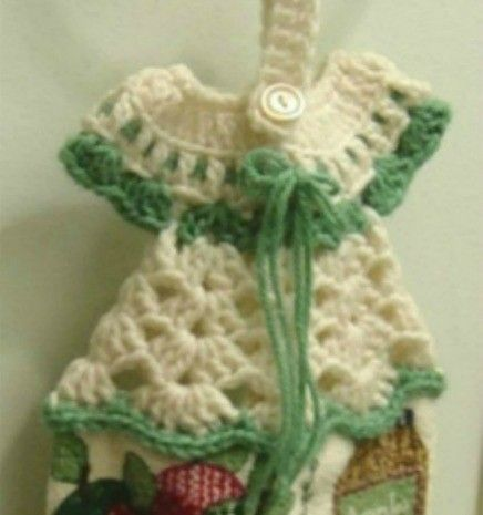 Crochet tops for kitchen towels are popular craft projects. This example explains how to make a really cute dress pattern towel topper. This is a guide about crocheted dress towel hanger.