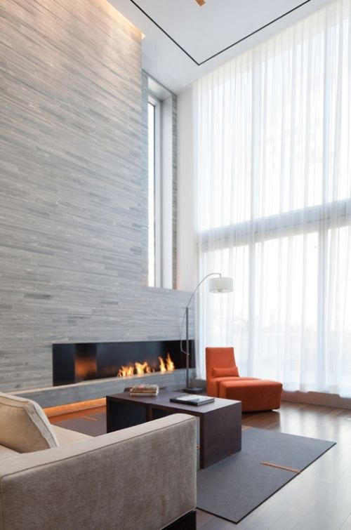 Fireplace.  Do I like the lighting underneath & wood floor?  Also good with concrete or marble