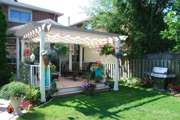 White colonial design pergola attached to house with off-white haromonica shade