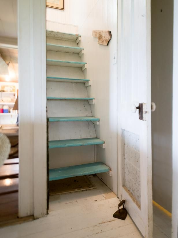 """Blog Cabin 2013: Before and After Pictures: Coined """"the jump,"""" the ship ladder-style staircase that leads from first to second floor spaces is dangerously steep and not up to current-day building codes. From DIYnetwork.com"""