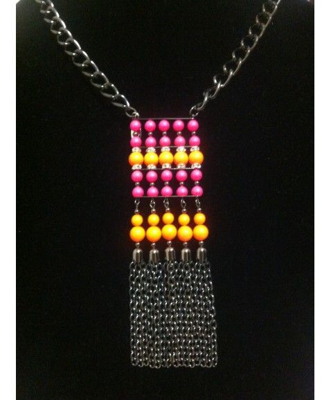 ILYAS HONEY PRIVET NECKLACE       ·      Designed & made in Perth, Western Australia  ·      Stunning Swarovski crystal neon orange and neon pink pearls  ·      Silver and crystal rondels for subtle touch of sparkle  ·      Black nickel chunky chain for excellent wearing  ·      Black nickel metal beads and findings