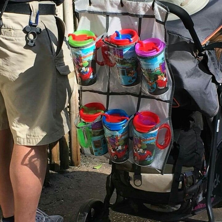 At Disney World, zip tie a small shoe organizer to your stroller for multiple drink holders