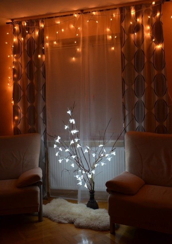 Branches In A Vase Decorated With Led Christmas Lights