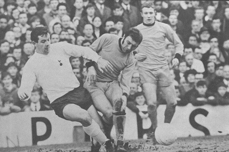 22nd February 1969. Spurs Alan Mullery and Wolves Mike Bailey tussle for the ball, at White Hart Lane.