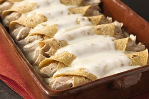 Green chili enchiladas are covered with queso blanco in this quick and easy Tex-Mex favorite. Good thing it's easy too—they'll ask for it again.