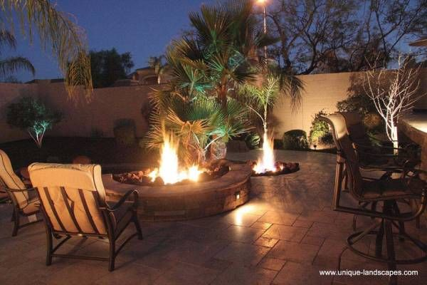 A light show of flames and shadows dance around this patio ...