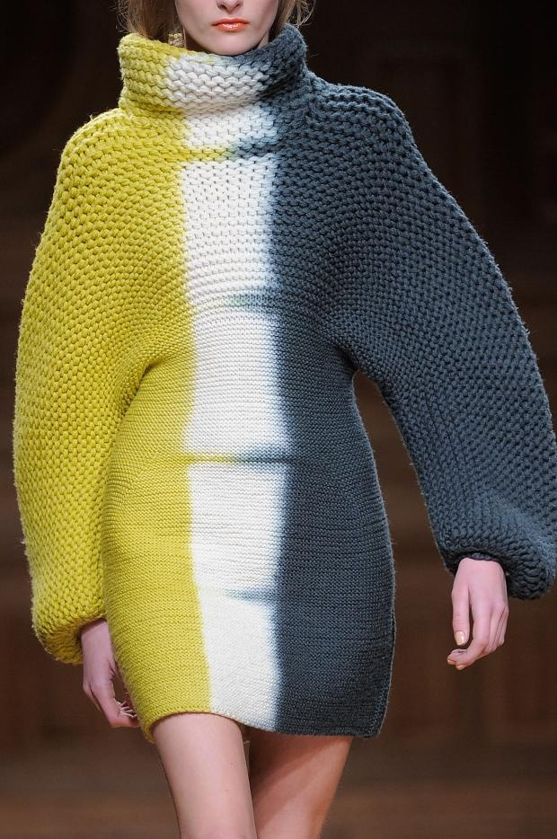"""""""Wijnants repeated those looks, or elaborations of them, throughout this collection; some of the punchiest pieces found him shibori-dying funnel-neck dresses and coat-length cardigans, to graphic effect."""" 