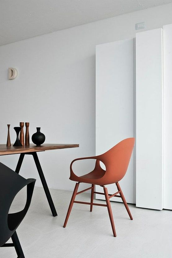 Dark orange minimalist chair. #minimalist #furniture #space #minimalistspace
