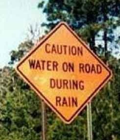 Caution Water On Road During Rain Rolling On The Floor