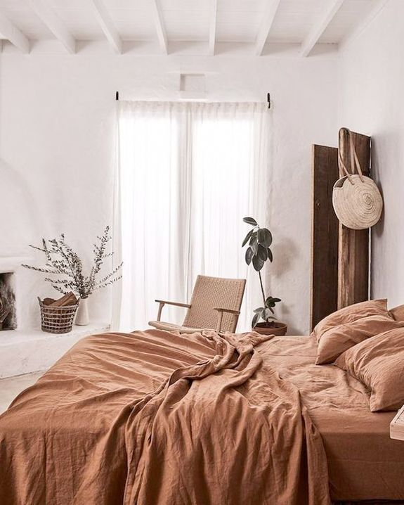 rust colored washed linen bedding. / sfgirlbybay