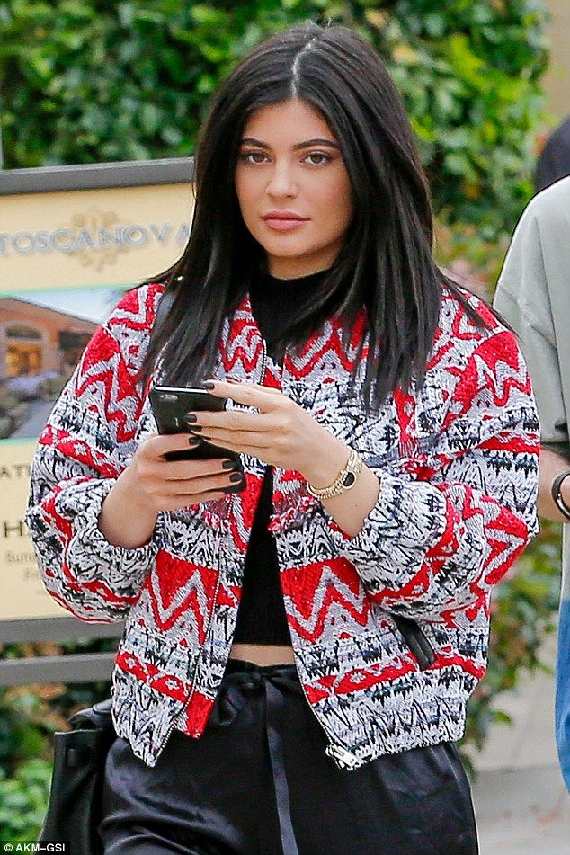 Braving the rain! Kylie Jenner heads out to lunch with her friends in Los Angeles on Thursday