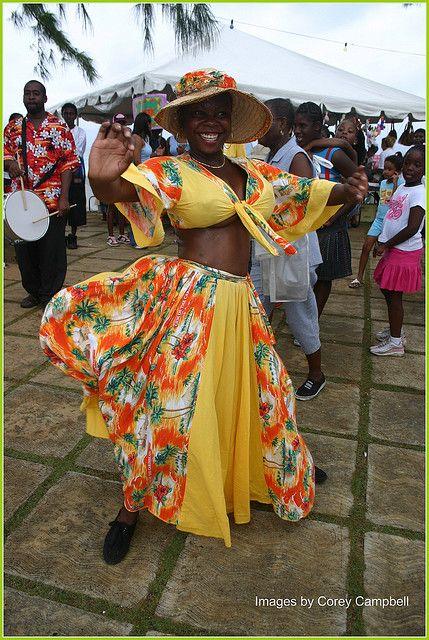 Bajan culture and beauty.    Bajan (slang for Barbadian) dancer performing with a Tuk band group