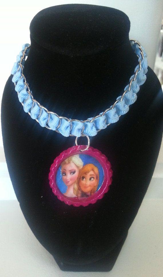 Frozen necklace.   https://www.etsy.com/listing/192895015/frozen-necklace-party-favor-elsa