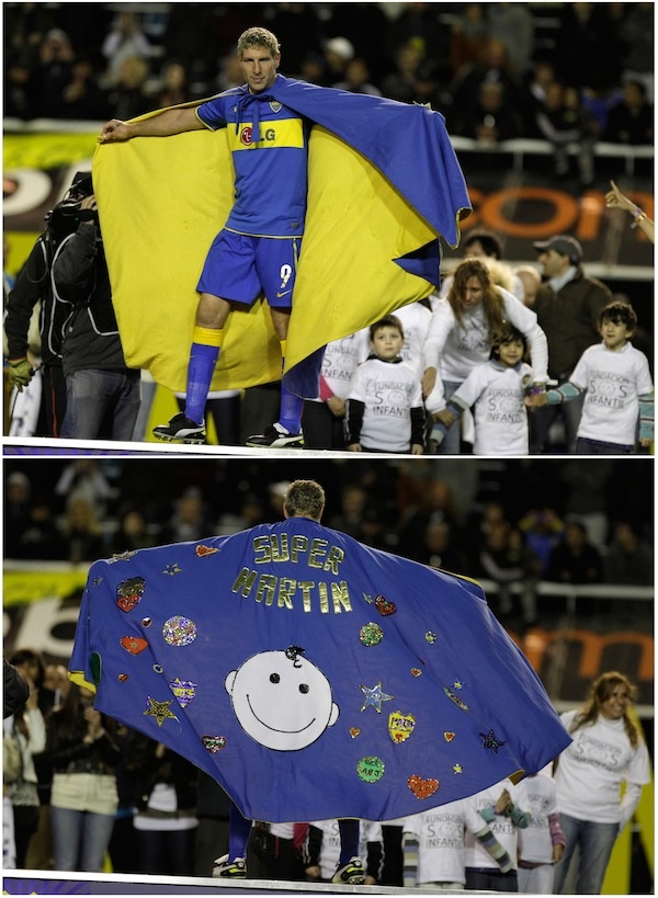 What an awesome retirement gift from the kids, and what class to wear it at the match. Go Martin Palermo.