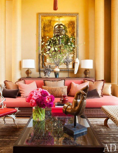 The living room's overscale sofa was custom made to fit in between two sets of towering columns, which are wrapped in jute rope.