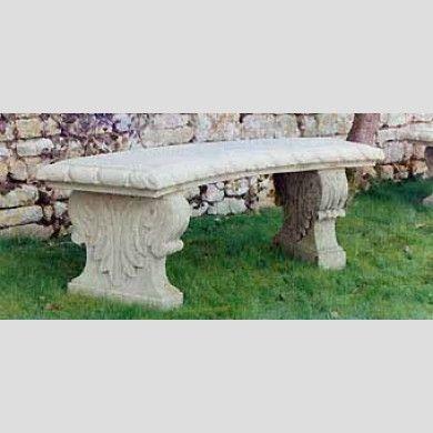 An English carved limestone garden bench